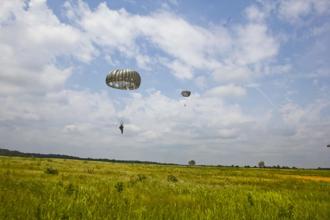 U.S. Army Reserve Paratroopers participate in an airborne operation hosted by the U.S. Army Civil Affairs & Psychological Operations Command (Airborne) at St. Mere Elise Drop Zone near Fort Bragg, N.C. on June 25, 2016.  USACAPOC (A), an Army Reserve unit, conducts airborne operations in order to maintain currency and proficiency. USACAPOC(A) supports the Army and Joint Force with strategic, operational, and tactical civil affairs, military information support, and information operations capabilities across the range of military operations. (U.S. Army photo by Staff Sgt. Felix R. Fimbres)
