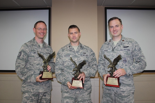 Three members of the Western Air Defense Sector are recognized by Continental U.S. North American Aerospace Defense Command Region - First Air Force (CONR-1AF) as outstanding performers.  Tech. Sgt. Ryc Cyr, left, is the Command and Control (C2) Enlisted Warrior of the Year; Capt. Tyler Royster, center, is the C2 Officer Warrior of the Year; and Maj. Antony Braun, right, is the Field Grade Officer of the Year.  Also, WADS was named the CONR-1AF Command and Control Unit of the Year.