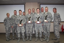 The Western Air Defense Sector wins First Air Force Command and Control Unit of the Year.  Individual unit members win the Field Grade Officer of the Year, Command and Control (C2) Officer Warrior of the Year, and C2 Enlisted Warrior of the Year.  Pictured from left to right are: Master Sgt. Dawn Kloos, 225th Air Defense Group (ADG) first sergeant; Chief Master Sgt. George Saratsis, First Air Force awards presenter; Capt. Tyler Royster, C2 Officer Warrior of the Year; Chief Master Sgt. Daniel Rebstock, 225th Support Squadron superintendent, Tech. Sgt. Ryc Cyr, C2 Enlisted Warrior of the Year; Lt. Col. Brett Bosselmann, 225th Air Defense Group commander; Maj. Antony Braun, Field Grade Officer of the Year; Col. William Krueger, 225th ADG commander; Col. Gregor Leist, Western Air Defense Sector commander; and Chief Master Sgt. Allan Lawson, 225th ADS superintendent.