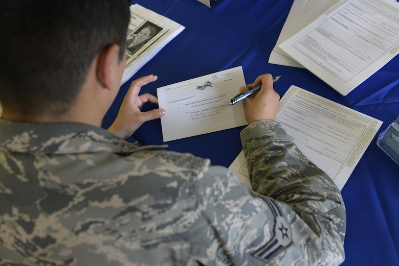 An Airman registers to vote at a voting-assistance table at Joint Base Elmendorf-Richardson, Alaska, June 27, 2016. The Federal Voting Assistance program ensures that overseas citizens and service members are given the opportunity to vote, through absentee ballots. (U.S. Air Force photo by Airman 1st Class Valerie Monroy)