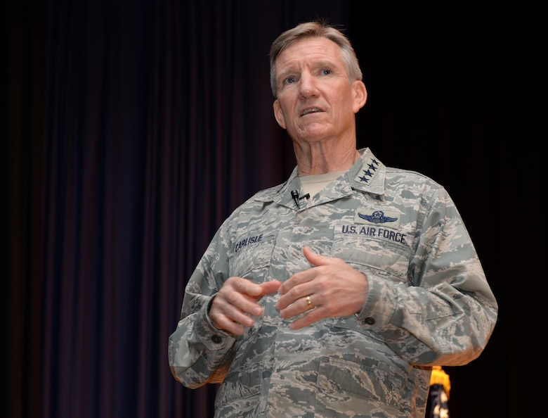 Gen. Hawk Carlisle, commander of Air Combat Command, speaks during an enlisted all-call at Joint Base Langley Eustis, June 28, 2016. Carlisle's presentation to the enlisted Airmen stationed here included facts about Operation Desert Storm, updates on the status of the Air Force and a question and answer session. At the conclusion of the enlisted call, Carlisle was presented with an invitation to be inducted into the Order of the Sword to recognize his dedication to the enlisted force during his 38 years of service. The Order of the Sword is the highest honor Air Force enlisted Airmen can bestow upon a commissioned officer who has made significant contributions to the enlisted force. (U.S. Air Force photo by Tech. Sgt. Steve Stanley/Released)