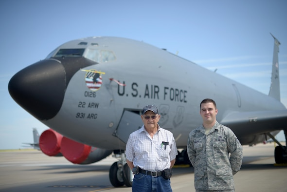 Staff Sgt. Austin Phillips, the 22nd Maintenance Squadron wheel and tire section chief poses with his grandfather, retired Staff Sgt. Raymond Hopper, in front of a KC-135 Stratotanker June 25, 2016, at McConnell Air Force Base, Kan. Phillips is assigned to the KC-135, the same aircraft his grandfather once worked on nearly 60 years before. (U.S. Air Force photo/Airman 1st Class Christopher Thornbury)