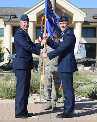 Lt. Col. Matthew Vollkommer, right, 434th Flying Training Squadron commander, poses for a photo with Col. Bryan Runkle, 47th Operations Group commander, during a change of command at Laughlin Air Force Base, Texas, June 23, 2016. Vollkommer came to Laughlin from his previous position as the 94th Fighter Squadron director of operations at Joint Base Langley-Eustis, Va. (U.S. Air Force photo/Senior Airman Jimmie D. Pike)