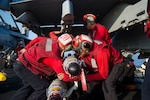Navy sailors prepare to load ordnance on an F/A-18E Super Hornet assigned to the Sidewinders of Strike Fighter Squadron 86 on the flight deck of the aircraft carrier USS Dwight D. Eisenhower in the Mediterranean Sea, June 28,2016. The Dwight D. Eisenhower is deployed in support of Operation Inherent Resolve, maritime security operations and theater security operation efforts in the U.S. 6th Fleet area of operations. U.S. Navy photo by Petty Officer 3rd Class Anderson W. Branch