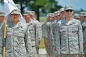 U.S. Airmen assigned to the Senior Master Sgt. David B. Reid Airman Leadership School Class 16-05 stand at attention during a final retreat ceremony at Shaw Air Force Base, S.C., June 27, 2016. ALS Airmen were observed by instructors and base leadership for precision and accuracy throughout the ceremony. (U.S. Air Force photo by Airman 1st Class Christopher Maldonado)