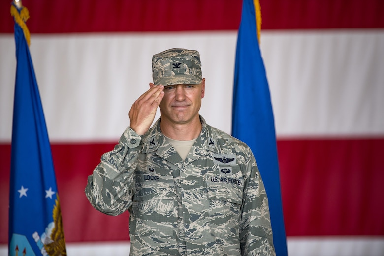 U.S. Air Force Col. Joseph Locke, 93d Air Ground Operations Wing commander, renders his final salute during a change of command ceremony, June 28, 2016 at Moody Air Force Base, Ga. After relinquishing command Locke will deploy to Southwest Asia where he will fly the A-29 Super Tucano.   (U.S. Air Force photo by Senior Airman Ryan Callaghan/Released)