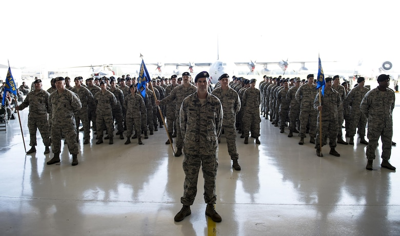 U.S. Air Force Airmen assigned to the 820th Base Defense Group prepare to render the final salute to Col. Joseph Locke, outgoing 93d Air Ground Operations Wing commander, during the 93d AGOW change of command ceremony, June 28, 2016, at Moody Air Force Base, Ga. Under Locke's command, Airmen assigned to the 93d AGOW have deployed to every continent except Antarctica. (U.S. Air Force photo by Airman 1st Class Janiqua P. Robinson/Released)