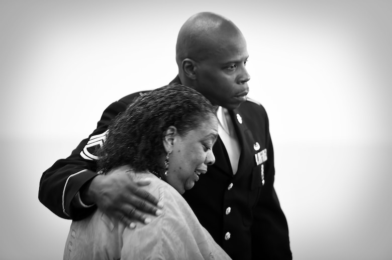 """Virginia """"Ginnie"""" Stephens is comforted by Sgt. First Class Gregory Santoni, assigned to the U.S. Army Reserve's 3rd Battalion, 383rd Regiment, during a Fallen Soldier memorial held June 25, 2016. The memorial, held at the battalion in St. Louis, was in honor of Capt. Antonio D. Brown, a 3-383rd member killed in the recent nightclub shooting in Orlando, Florida. (U.S. Army photo by Sgt. Aaron Berogan/Released)"""