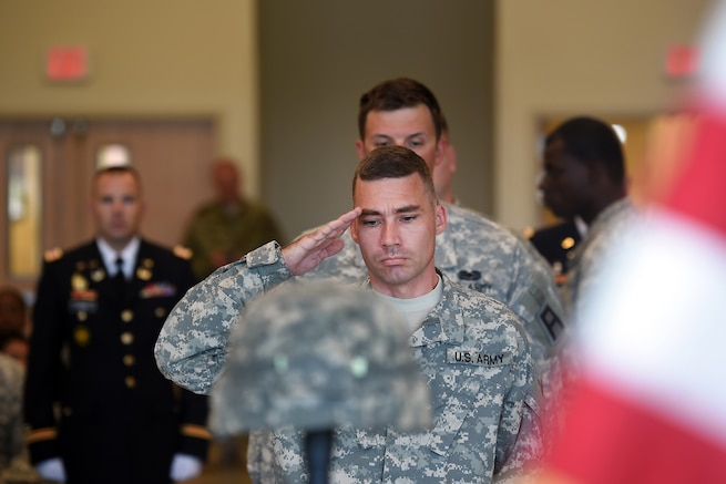 A soldier assigned to the U.S. Army Reserve's 3rd Battalion, 383rd Regiment salutes the Fallen Soldier battle cross display during a Fallen Soldier memorial held June 25, 2016 at the battalion in St. Louis. Capt. Antonio D. Brown, a 3-383rd member, was one of the 49 victims killed in the Orlando nightclub shooting June 12, 2016.