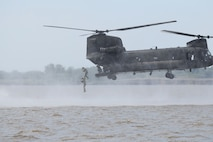Members of Company C, Long Range Surveillance, 1st Squadron, 134th Cavalry Regiment, Nebraska Army National Guard, perform a Hollywood jump from a CH-47 Chinook June 11 at Milford Lake.