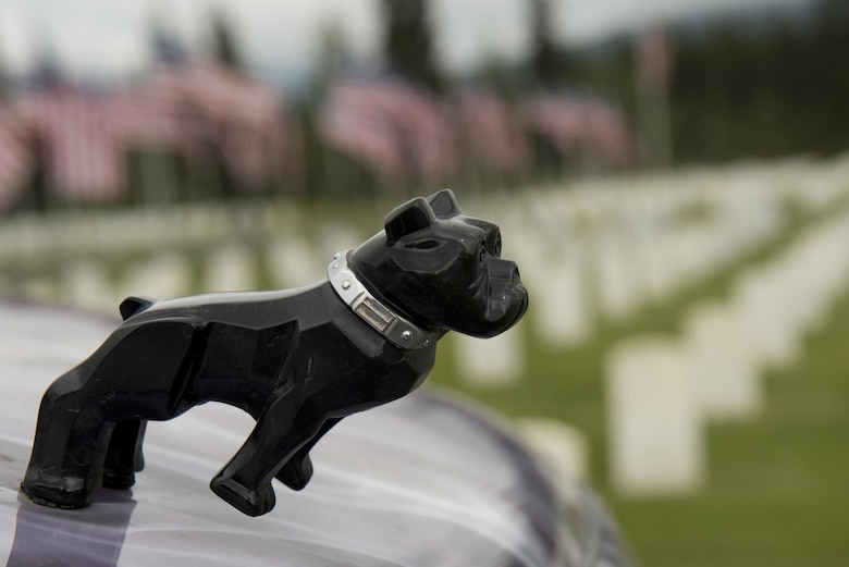 "A miniature bulldog figurine was seen on the hood of a vehicle at the funeral for Fred ""Bulldog"" Becker IV June 24. Bulldog was a USAF Vietnam veteran who dedicated his life to bringing respect and recognition to active duty service members. (U.S. Air Force photo by Senior Airman Kyle Johnson)"