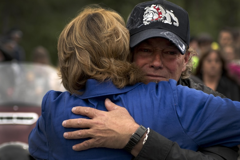 "Fred Becker V hugs Alaska Senator Lisa Murkowski at the funeral for his father, Fred ""Bulldog"" Becker IV, June 24. Bulldog was heavily involved in the Anchorage community, and more than 1,000 Airmen and Soldiers lined the streets for his processional, consisting of hundreds of motorcyclists from around the community. (U.S. Air Force photo by Senior Airman Kyle Johnson)"