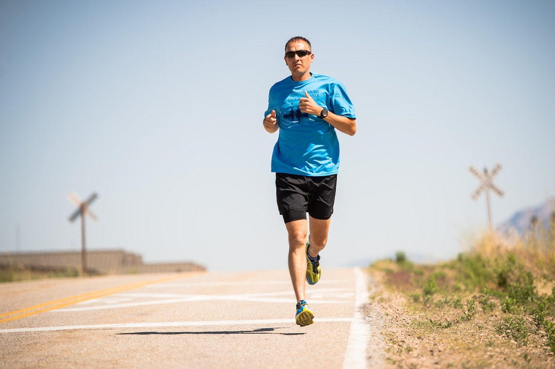 Capt. Jared Struck, an aircraft maintenance officer assigned to the Ogden Air Logistics Complex, runs at Hill Air Force Base, June 27. Struck is training to run the Badwater ultramarathon in July and will raise money for Fisher House, an organization that benefits military families with no-cost housing near medical facilities when loved ones are receiving medical treatment. (U.S. Air Force photo by R. Nial Bradshaw)