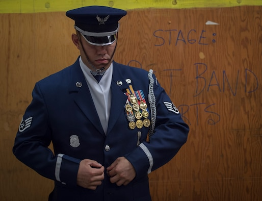 Staff Sgt. Alfredo Caballero, U.S. Air Force Honor Guard Drill Team member, dons his ceremonial uniform in preparation for a 2016 Royal Nova Scotia International Tattoo full-dress rehearsal at the Scotiabank Centre in Halifax, Nova Scotia, June 27, 2016. This is the first time in 20 years that a U.S. Military team has performed at this event. (U.S. Air Force photo by Senior Airman Ryan J. Sonnier)