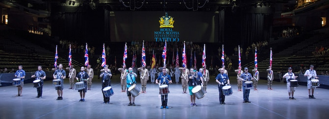 Members of the 2016 Royal Nova Scotia International Tattoo practice an opening sequence during a rehearsal at the Scotiabank Centre in Halifax, Nova Scotia, June 26, 2016. The six countries scheduled to perform help portray the theme of the show, 'Bond of Friendship.' (U.S. Air Force photo by Senior Airman Ryan J. Sonnier)