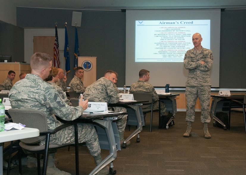 Chief Ronald C. Anderson, the 12th Air National Guard Command Chief listens to question from newly promoted ANG chief during Chiefs Executive Course at the ANG Readiness Center, Joint Base Andrews June 21, 2016. CEC is a weeklong course designed to provide new chief master sergeants with a broad view of ANG and Air Force operations and provide them with tools to operate effectively at the tactical and operational levels. (U.S. Air National Guard Photo by Master Sgt. David J. Fenner /RELEASED)
