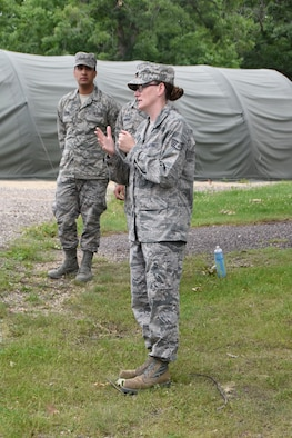 VOLK FIELD, WI- Staff Sgt. Dena Leonard, 114th Services Flight shelter platform expert, briefs Airmen prior to assembling the small shelter system during home station training June 20-26.  (U.S. Air National Guard photo by Tech. Sgt. Abbey Rotter/Released)