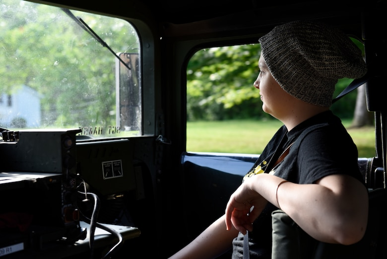 The U.S. Army Reserve 983rd Engineer Battalion escorted Ashleigh Hunt, a 22 year-old Ohio resident diagnosed with osteosarcoma, in a humvee to the 180th Fighter Wing in Swanton, Ohio where she was designated a pilot for a day May 26, 2016. During the Pilot for a Day event, Hunt was commissioned as an honorary 2nd Lt., launched an F-16 Fighting Falcon, received a tour of the base facilities, and experienced basic pilot survival and parachute training. (U.S. Air National Guard photo by Staff Sgt. Shane Hughes)