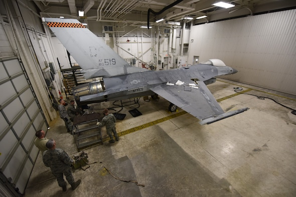 180FW Airmen begin the six-week process of transforming a retired F-16 to look like new with 180FW markings. U.S. Air National Guard photo by Staff Sgt. John Wilkes.