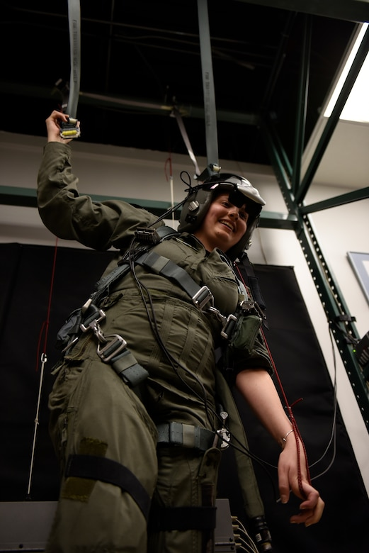 Honorary 2nd Lt. Ashleigh Hunt trains in a parachute simulator May 26, 2016 during Pilot for a Day, a program supporting children and young adults who live with chronic or life-threatening illnesses. Hunt, who was diagnosed with osteosarcoma at 19, was honored during the first-ever Pilot for a Day event at the 180th Fighter Wing where she launched an F-16 Fighting Falcon, received a tour of the base facilities, and experienced basic pilot survival training. (U.S. Air National Guard photo by Staff Sgt. Shane Hughes)