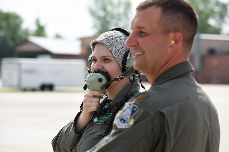 Honorary 2nd Lt. Ashleigh Hunt launches an f-16 Fighting Falcon as U.S. Air Force Maj. Brian Cherolis, an F-16 pilot assigned to the 180th Fighter Wing, supervises on the flight line May 26, 2016 during Pilot for a Day, a program supporting children and young adults who live with chronic or life-threatening illnesses. The Pilot for a Day program allows the 180FW to give back to the local community, whose enduring support for the Airmen makes the 180FW mission possible. (U.S. Air National Guard photo by Staff Sgt. Shane Hughes)