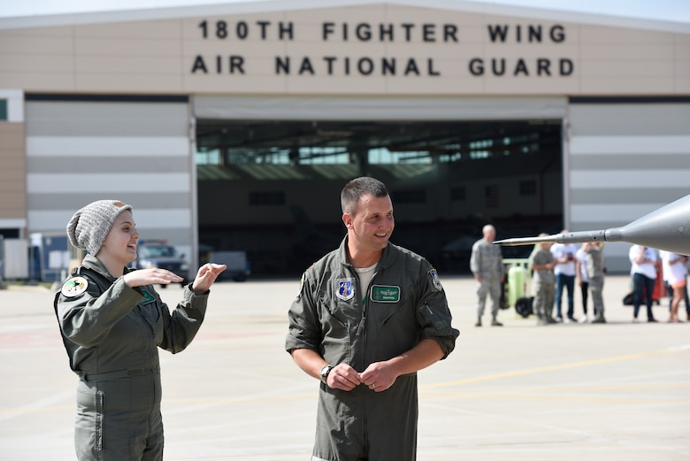 Honorary 2nd Lt. Ashleigh Hunt and U.S. Air Force Maj. Brian Cherolis, an F-16 Fighting Falcon pilot assigned to the 180th Fighter Wing, talk on the flight line prior to take-off May 26, 2016 during Pilot for a Day, a program supporting children and young adults who live with chronic or life-threatening illnesses. The Pilot for a Day program allows the 180FW to give back to the local community, whose enduring support for the Airmen makes the 180FW mission possible. (U.S. Air National Guard photo by Staff Sgt. Shane Hughes)