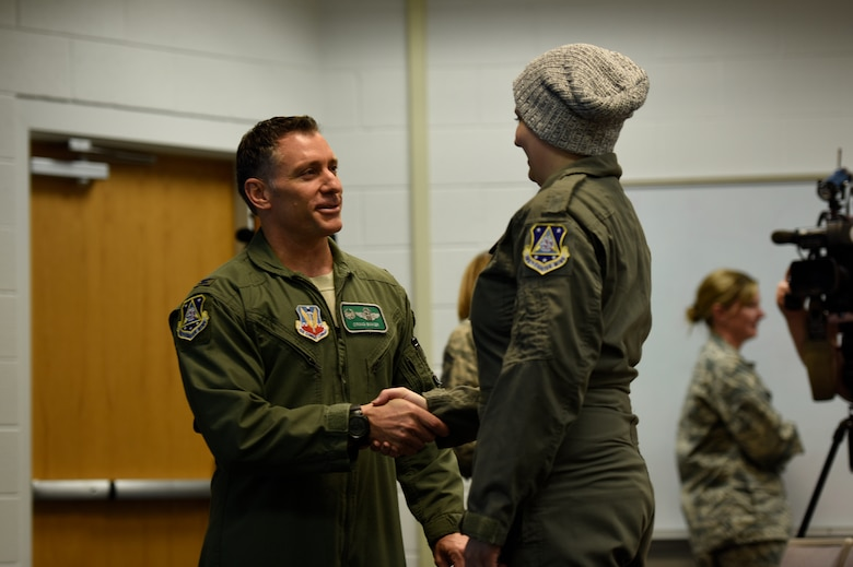 U.S. Air Force Col. Craig R. Baker, the 180th Fighter Wing Commander, congratulates honorary 2nd Lt. Ashleigh Hunt after her commissioning ceremony May 26, 2016, at the 180FW in Swanton, Ohio. Hunt, who was diagnosed with osteosarcoma at 19, was honored during the first-ever Pilot for a Day event at the 180FW where she launched an F-16 Fighting Falcon, received a tour of the base facilities, and experienced basic pilot survival and parachute training. (U.S. Air National Guard photo by Staff Sgt. Shane Hughes)