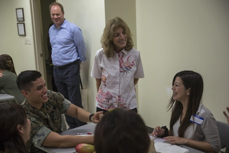 Ambassador to Japan Caroline Kennedy and Lance Cpl. Keven Romero interact with students during a service member-taught English class June 22 aboard Camp Schwab, Okinawa, Japan. For the past 14 years, Marines aboard Camp Schwab have been teaching children and young adults basic grammar and commonly used words for communication. According to Romero, they not only learned from and taught their Okinawan neighbors, but they continue to build on a bond 71 years in the making. Romero is a warehouse clerk with Combat Assault Battalion, 3rd Marine Division, III Marine Expeditionary Force.