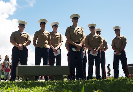 U.S. Marines stand to honor the fallen during the 2016 Okinawa Memorial services June 23 at Peace Memorial Park, Itoman, Japan. The ceremony brought Okinawa residents and Status of Forces Agreement members together to honor those whose lives were lost in the Battle of Okinawa. During the ceremony, distinguished guest speakers gave speeches to honor the fallen in the Battle of Okinawa and laid wreaths at the memorial walls, on which the names of the fallen were engraved. Attendees, in turn, took a moment of silence and paid tribute to the fallen heroes.