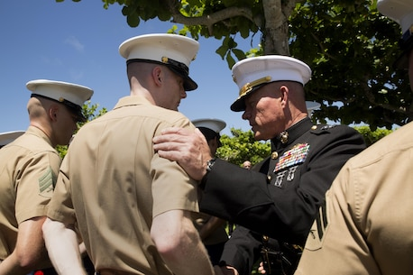 Lt. Gen. Lawrence Nicholson, right, greets Marines attending the 2016 Okinawa Memorial services June 23 at Okinawa Peace Memorial Park, Itoman, Okinawa, Japan. The ceremony brought Okinawa residents and Status of Forces Agreement members together to honor those whose lives were lost in the Battle of Okinawa. During the ceremony, distinguished guest speakers gave speeches to honor the fallen in the Battle of Okinawa and laid wreaths at the memorial walls, on which the names of the fallen were engraved. Attendees, in turn, took a moment of silence and paid tribute to the fallen heroes.  Nicholson is the III Marine Expeditionary Force commanding general and the Okinawa Area Coordinator.