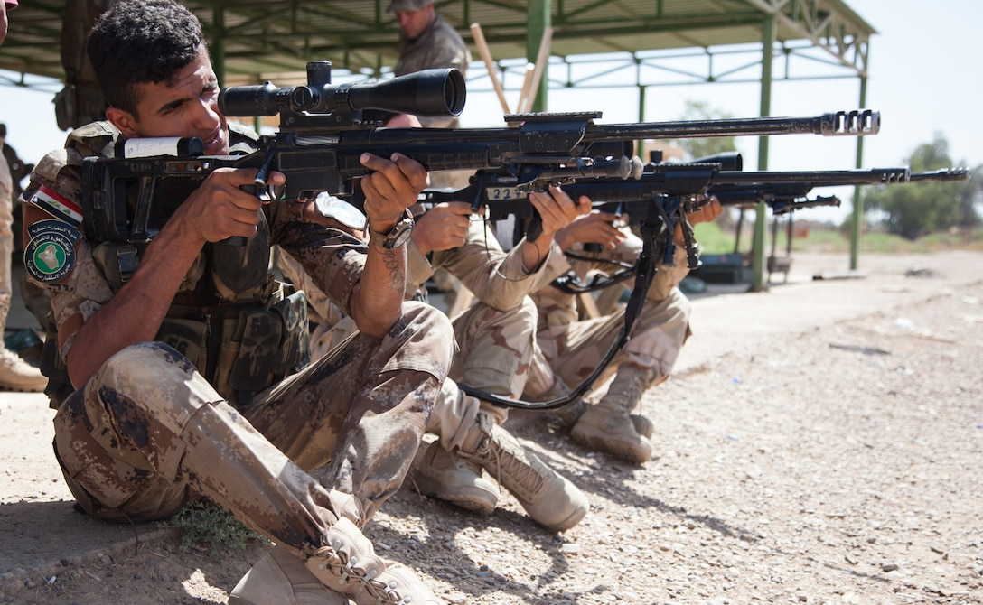 Iraqi soldiers practice their sitting firing position earlier this month at Camp Taji, Iraq. Defense Secretary Ash Carter has priased Iraqi security forces for their work in liberating the city of Fallujah from ISIL. (U.S. Army photo by Spc. Jessica Hurst)