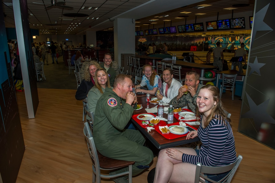 The 52nd Fighter Wing leadership and their family members grab a bite to eat at the newly reopened Eifel Lanes Bowling Center on Spangdahlem Air Base, Germany, June 28, 2016. The bowling center, which had been undergoing renovations since earlier this year, completed a final inspection without any discrepancies allowing it to open ahead of schedule. (U.S. Air Force photo by Senior Airman Luke Kitterman/Released)