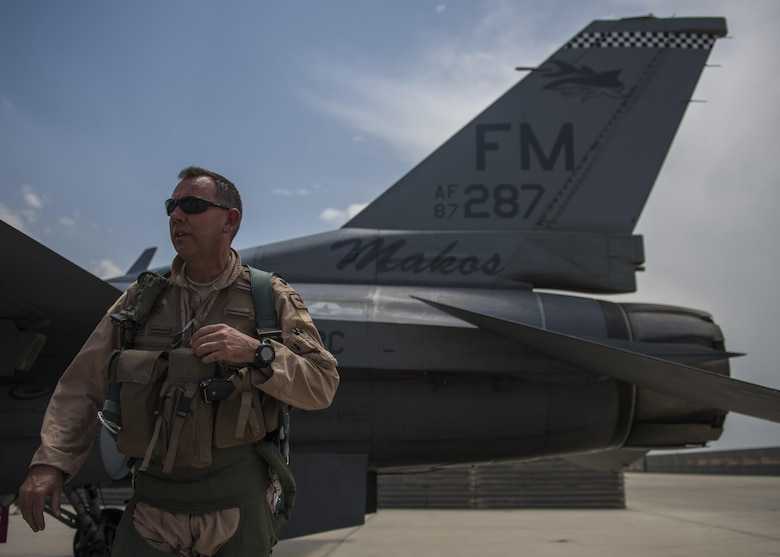 Lt. Col. David Efferson, 457th Expeditionary Fighter Squadron commander, conducts a pre-flight inspection of an F-16C Fighting Falcon, June 28, 2016, Bagram Airfield, Afghanistan. The aircraft receives inspections before takeoff and after landing to see if there are any maintenance issues with the aircraft. (U.S. Air Force photo by Senior Airman Justyn M. Freeman)