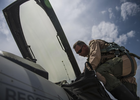 Lt. Col. David Efferson, 457th Expeditionary Fighter Squadron commander, climbs in the cockpit of an F-16C Fighting Falcon, June 28, 2016, Bagram Airfield, Afghanistan. The mission of the F-16C is to provide close air support for Operation Freedom's Sentinel. (U.S. Air Force photo by Senior Airman Justyn M. Freeman)