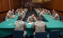 U.S. Air Force officers and senior NCOs attend a speed mentoring session at Club Eifel on Spangdahlem Air Base, Germany, June 28, 2016. The session provided an environment in which company grade officers could ask for and receive advice from senior NCOs in three-minute intervals. (U.S. Air Force photo by Airman 1st Class Timothy Kim/Released)