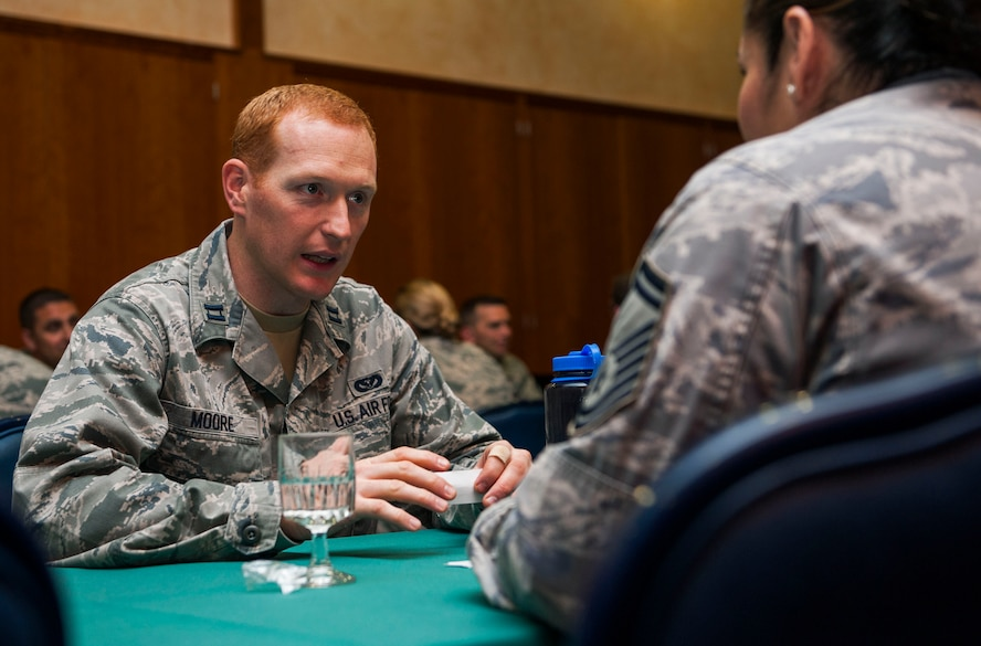 U.S. Air Force Capt. Brigham Moore, 52nd Civil Engineer Squadron operations engineering chief, speaks with a senior NCO mentor during a speed mentoring session at Club Eifel on Spangdahlem Air Base, Germany, June 28, 2016. All 13 company grade officers had the opportunity to meet and receive advice on leadership from all 19 senior NCOs. (U.S. Air Force photo by Airman 1st Class Timothy Kim/Released)