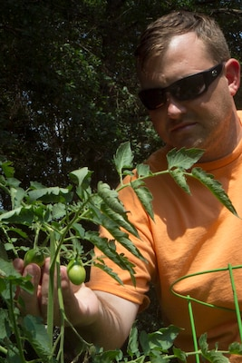 U.S. Army Staff Sgt. Michael Hutcheson, South Carolina National Guard, gardens at his home in Irmo, South Carolina, June 27, 2016, in order to gain a sense of purpose separate from being a Soldier to combat certain Post Traumatic Stress Disorder symptoms. Hutcheson has been battling PTSD as a result of multiple combat deployments in support of both Operation Iraqi Freedom and Operation Enduring Freedom.
