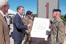 Kansas Governor Sam Brownback and Maj. Gen. Wayne W. Grigsby Jr., 1st Infantry Division and Fort Riley com¬manding general, discuss the 100th Anniversary Com-mittee Charter on June 6 after a signing ceremony at Fort Riley.