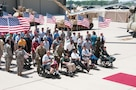 Vietnam veterans prepare to make their grand entrance at the Vietnam Veterans Welcome Home ceremony June 8 at the Fort Riley Marshall Army Airfield. Service members from all branches entered the hangar to standing applause during the 1st Infantry Division's Victory Week.