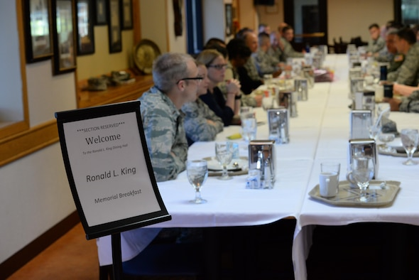 Members of the 55th Contracting Squadron at Offutt Air Force Base, Neb., gather in the Ronald L. King Dining Facility at Offutt June 24, 2016 to commemorate the 20th anniversary of Staff Sgt. Ronald L. King's death June 24, 2016. King, a former member of the 55th CONS, died in the the attack on Khobar Towers, in Dhahran, Saudi Arabia, June 25, 1996.