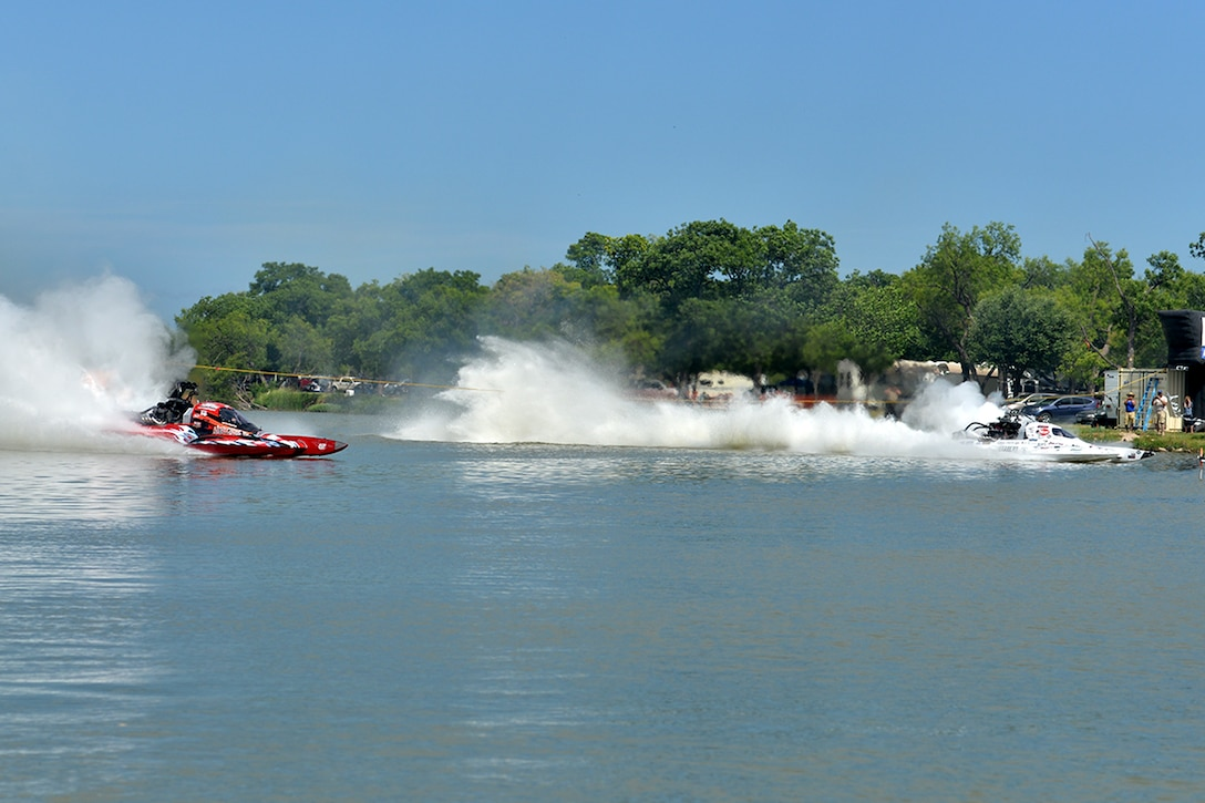 Drag boat drivers race in a liquid quarter mile during the 2016 Showdown in San Angelo Super Nationals drag boat races at Lake Nasworthy, San Angelo, Texas, June 25, 2016. The Showdown brings in people from around the nation and the Goodfellow volunteers ensure that the lake was kept clean. (U.S. Air Force photo by Airman 1st Class Randall Moose/Released)