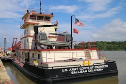 The Tulsa District U.S. Army Corps of Engineers navigation maintenance vessel, Mr. Pat, sits docked at Robert S. Kerr Lake on the McClellan-Kerr Arkansas River Navigation System near Sallisaw, Oklahoma, June 15, 2016. Mr. Pat was christened and put into service at the District on June 28, 1996, and has been instrumental in the facilitation of maintenance along the Tulsa District's portion of the MKARNS. (U.S. Army Corps of Engineers photo by Preston Chasteen/Released)