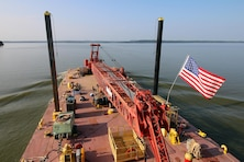 The Tulsa District U.S. Army Corps of Engineers navigation maintenance vessel, Mr. Pat, travels across Robert S. Kerr Lake on the McClellan-Kerr Arkansas River Navigation System to perform maintenance at Lock and Dam 15, near Sallisaw, Oklahoma, June 15, 2016. Mr. Pat was christened and put into service at the District on June 28, 1996, and for the past 20 years has been instrumental in the facilitation of maintenance along the Tulsa District's portion of the MKARNS. (U.S. Army Corps of Engineers photo by Preston Chasteen/Released)