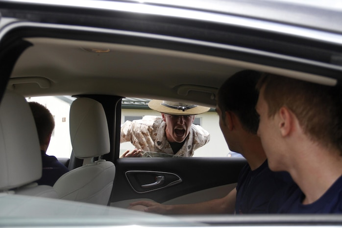 Staff Sgt. Jamie L. Murray, a Company P, 4th Battlation, Marine Corps Recruit Depot Parris Island chief drill instructor, instructs poolees to exit their vehicle after they arrived for Marine Corps Recruiting Station Kansas City's all-hands pool functionat Camp Clark in Nevada, Mo., June 24, 2016.