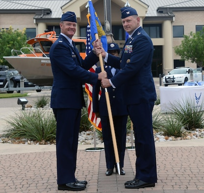 Col. Brian Hinsvark, right, 47th Mission Support Group commander, poses for a photo with Col. Thomas Shank, 47th Flying Training Wing commander, during a change of command at Laughlin Air Force Base, Texas, June 27, 2016. Hinsvark came to Laughlin from his previous position as a student at the Naval War College, Newport, R.I. (U.S. Air Force photo/Airman 1st Class Brandon May)