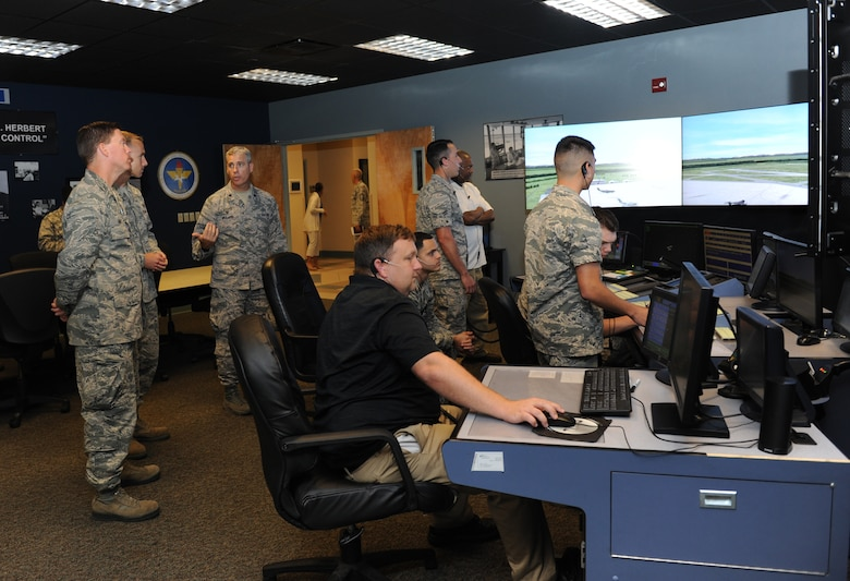 Lt. Col. Steven Mullins, 334th Training Squadron commander, briefs Col. C. Mike Smith, 81st Training Wing vice commander, on the air traffic control tower simulator training course at Cody Hall during an 81st Training Group immersion tour June 22, 2016 on Keesler Air Force Base, Miss. The purpose of the tour was to become familiar with the group's mission, operations and personnel. (U.S. Air Force photo by Kemberly Groue/Released)