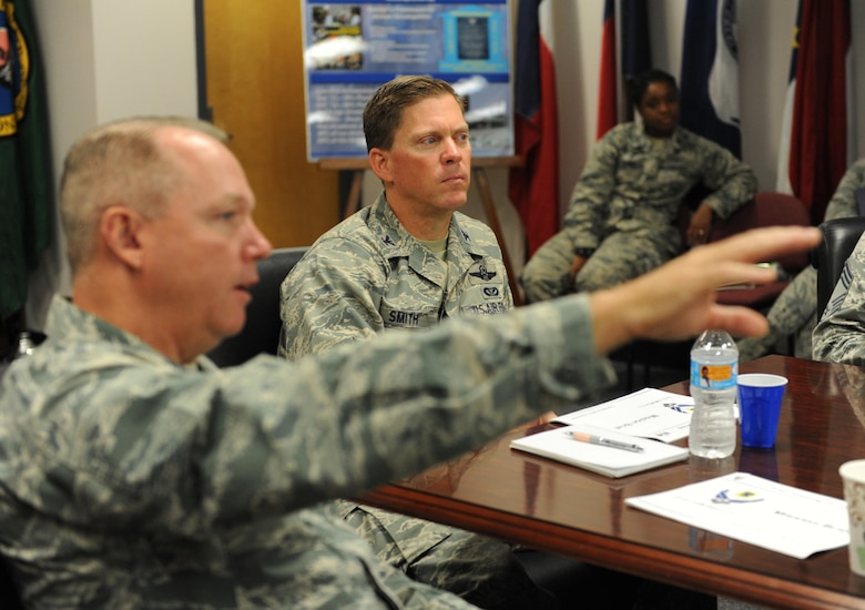 Col. C. Mike Smith, 81st Training Wing vice commander, receives a briefing from Col. Scott Solomon, 81st Training Group commander, during an immersion tour at the Levitow Training Support Facility June 22, 2016 on Keesler Air Force Base, Miss. The purpose of the tour was to become familiar with the group's mission, operations and personnel. (U.S. Air Force photo by Kemberly Groue/Released)