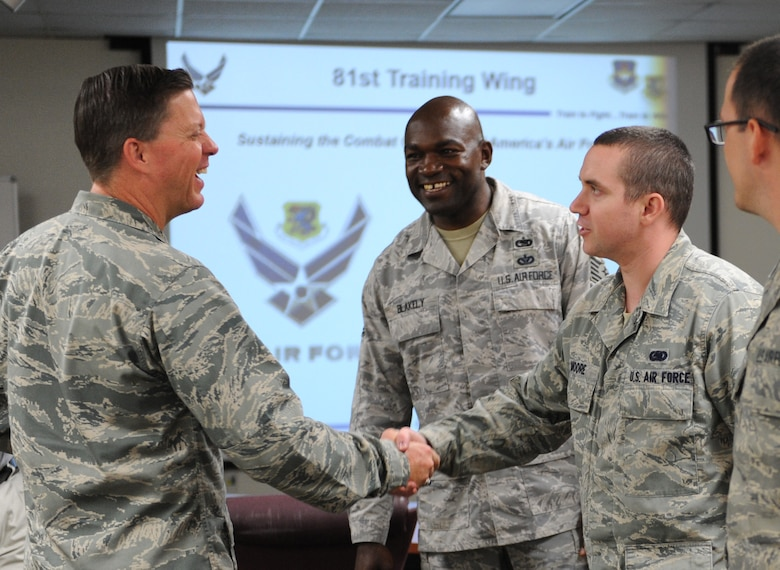 Col. C. Mike Smith, 81st Training Wing vice commander, is introduced to Tech. Sgt. Johnny Blakely, 81st Logistics Readiness Squadron deployment plans and integration NCO in charge, and Senior Airman Willie Moore II, 81st LRS deployment planning and execution supervisor, at the Taylor Logistics Center during an 81st Mission Support Group immersion tour June 23, 2016 on Keesler Air Force Base, Miss. The purpose of the tour was to become familiar with the group's mission, operations and personnel. (U.S. Air Force photo by Kemberly Groue/Released)