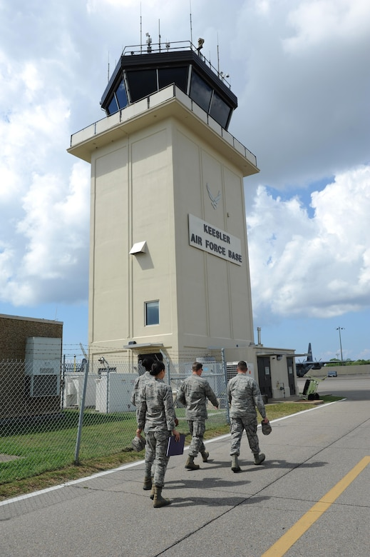 Col. C. Mike Smith, 81st Training Wing vice commander, walks to the air traffic control tower for a tour during an 81st Mission Support Group immersion tour June 24, 2016 on Keesler Air Force Base, Miss. The purpose of the tour was to become familiar with the group's mission, operations and personnel. (U.S. Air Force photo by Kemberly Groue/Released)
