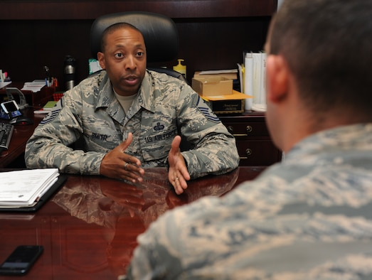 Master Sgt. Linford Smith, 81st Force Support Squadron first sergeant, provides feedback to an Airman June 9, 2016 on Keesler Air Force Base, Miss. A first sergeant's role within a unit is to be a dedicated focal point for all readiness, health, morale, welfare and quality-of-life issues  of the organization's airmen. (U.S. Air Force photo by Kemberly Groue/Released)